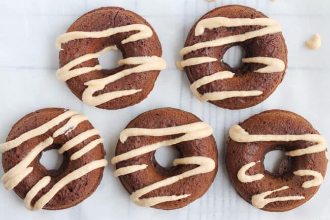 pumpkin-donuts-on-parchment-paper