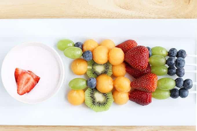 fruit-sticks-on-white-plate