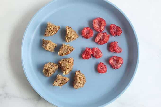 baby-mufifn-and-raspberries-on-blue-plate