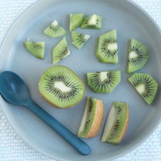 cut-up-kiwi-on-gray-plate