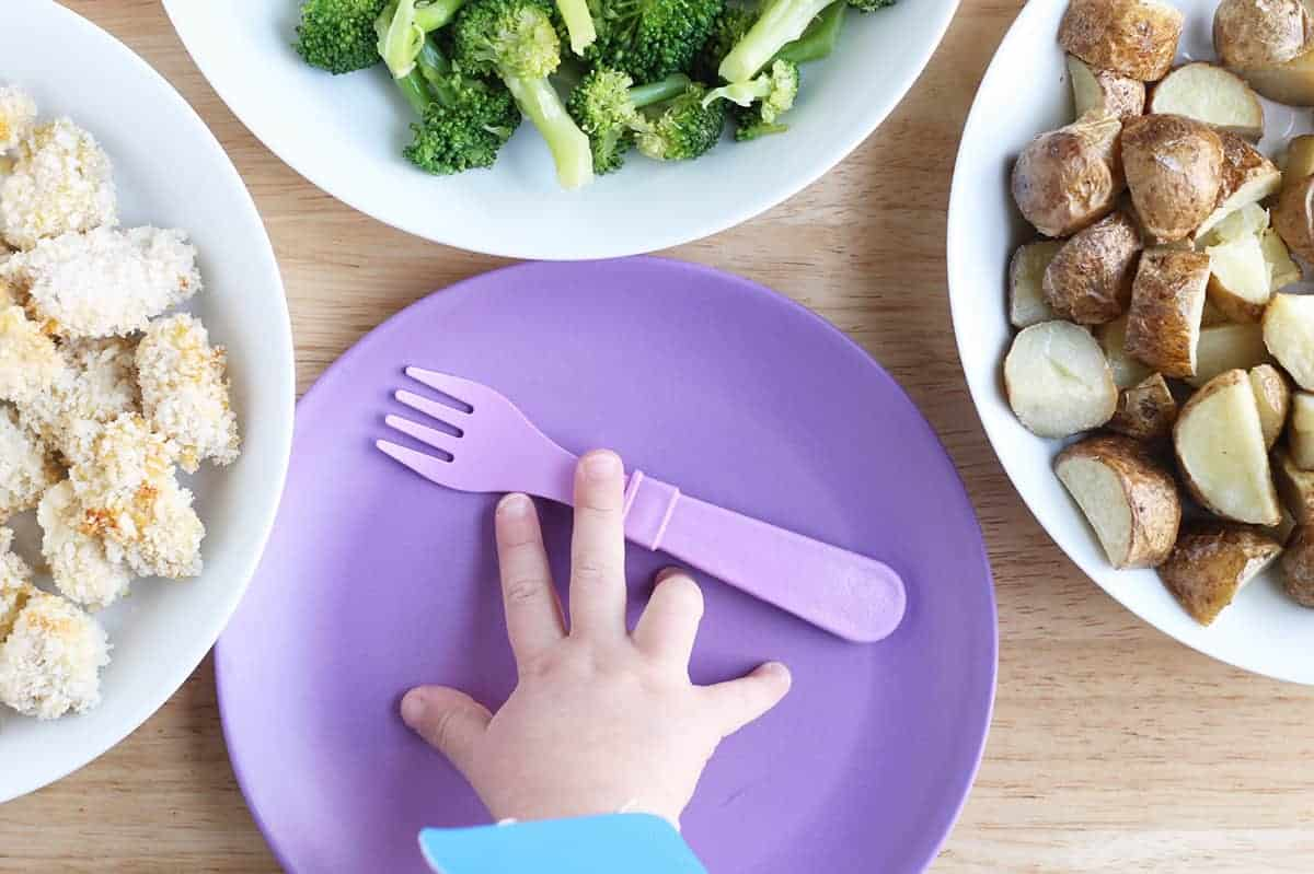 family-style-meal-with-toddler-hand