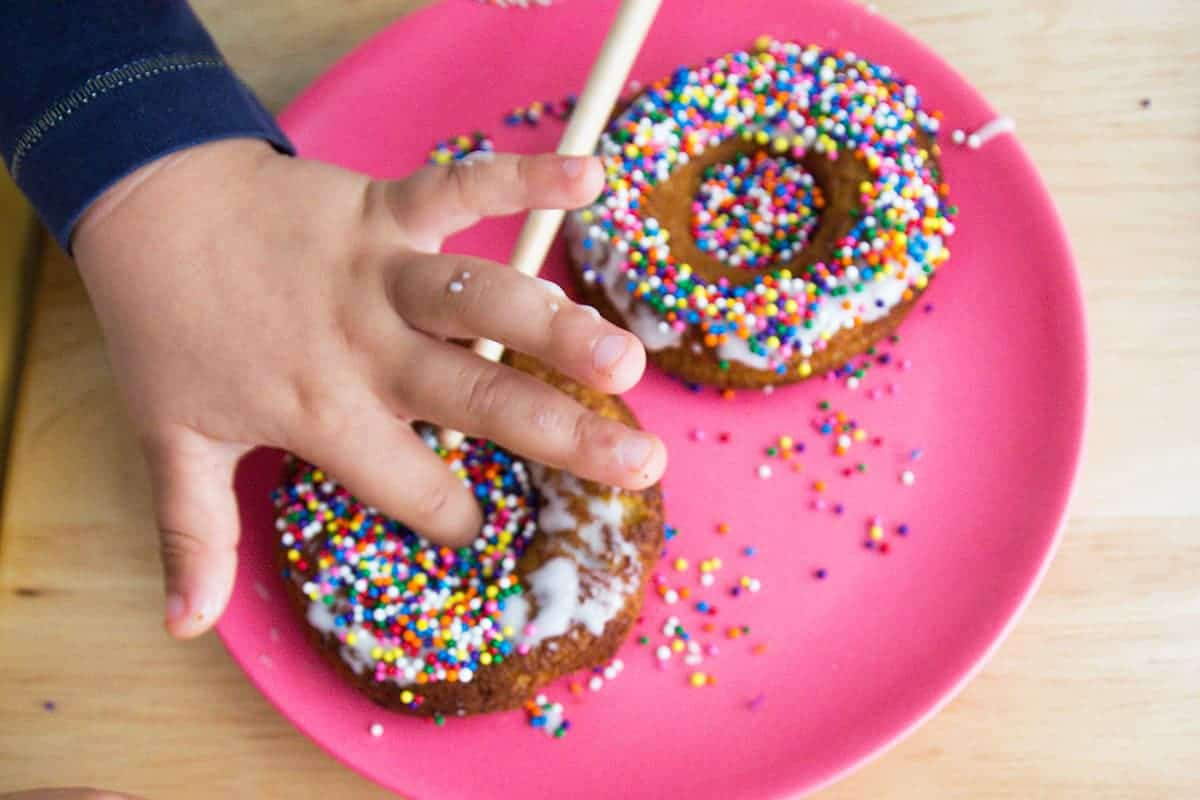donuts-and-toddler-hands-with-pink-plate