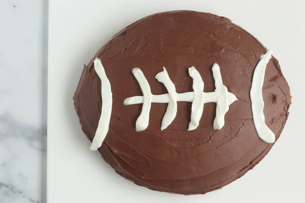 chocolate-football-cake-on-cutting-board