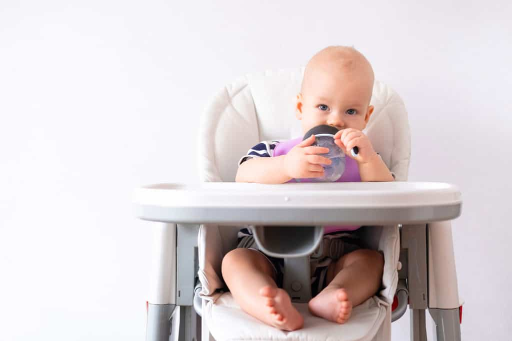 baby-drinking-water-in-highchair