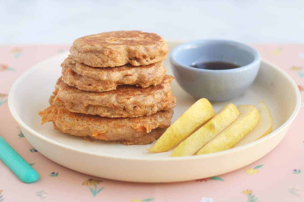 carrot-pancakes-in-stack-on-plate-with-pear
