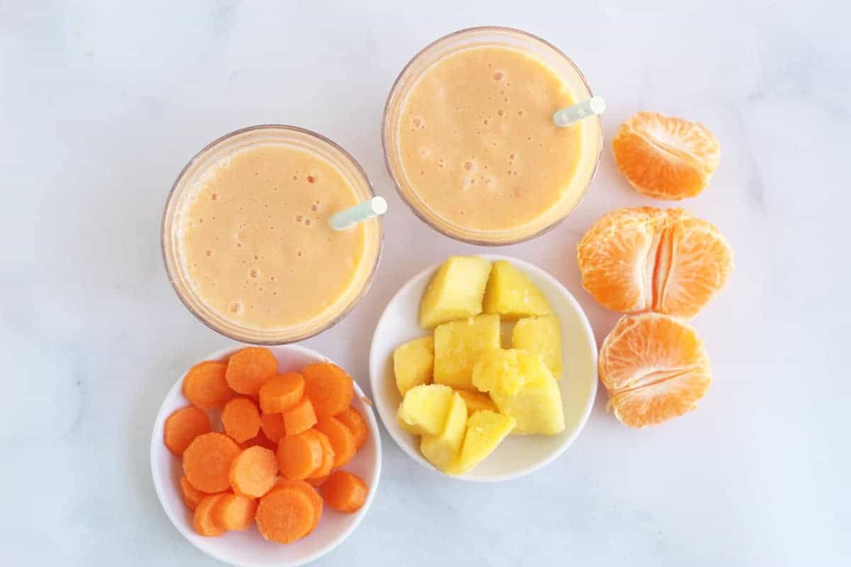 carrot-smoothie-with-ingredients-on-counter