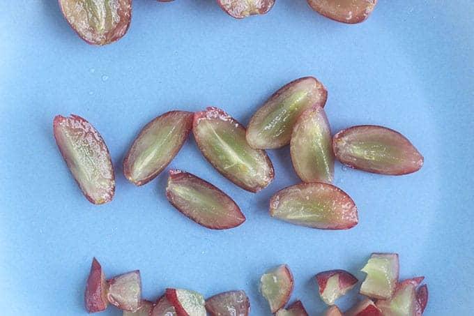 quartered-grapes-on-blue-plate