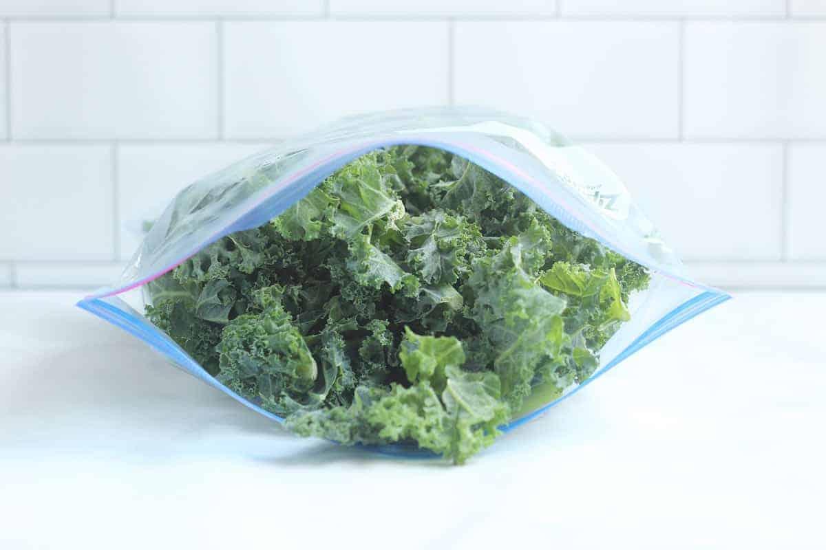 kale in freezer bag on countertop