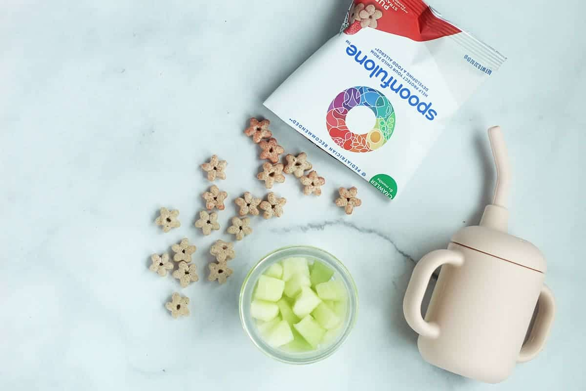 puffs, honeydew and baby cup on counter
