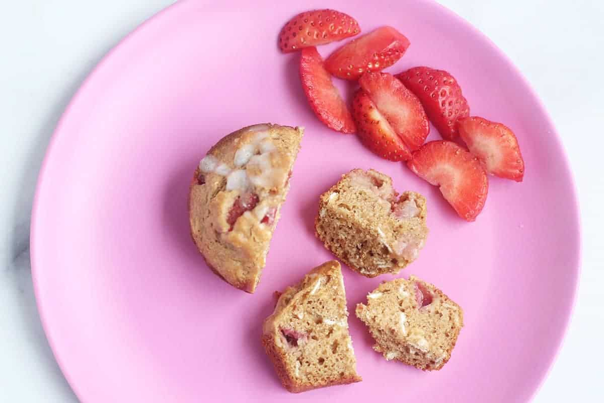 sliced strawberry muffin on plate