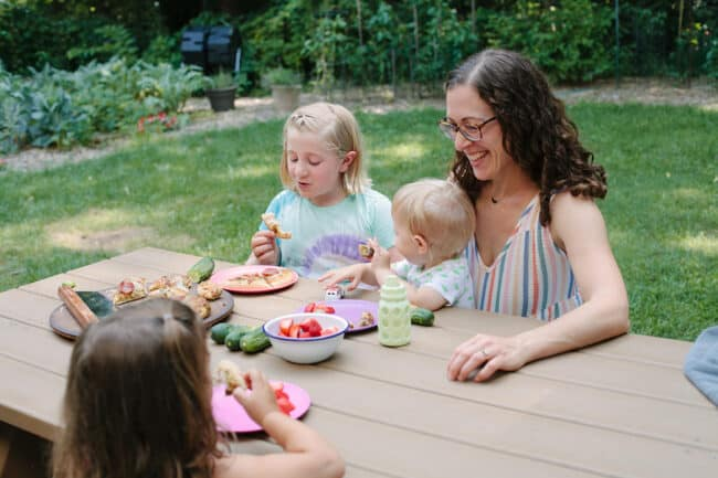 amy-at-picnic-table-with-kids