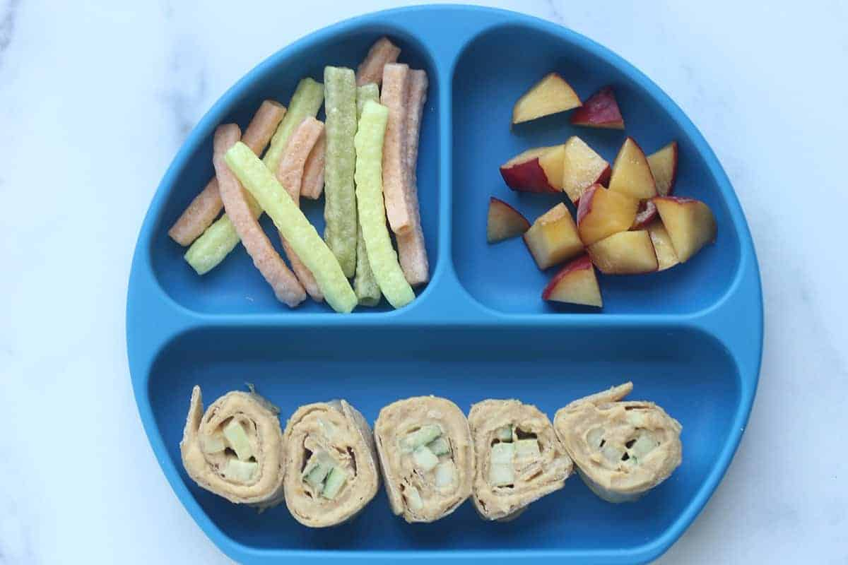 hummus-and-cucumber-wrap-on-blue-plate