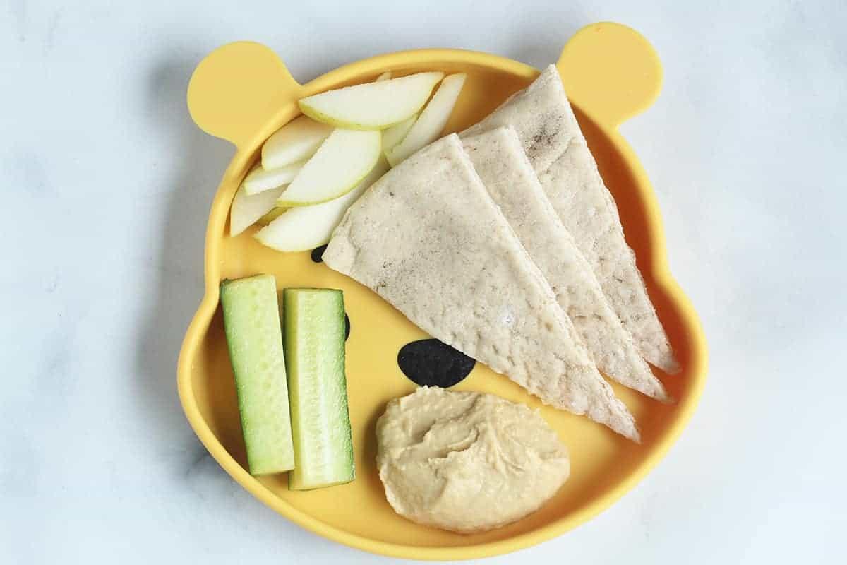 hummus and pita on pooh plate