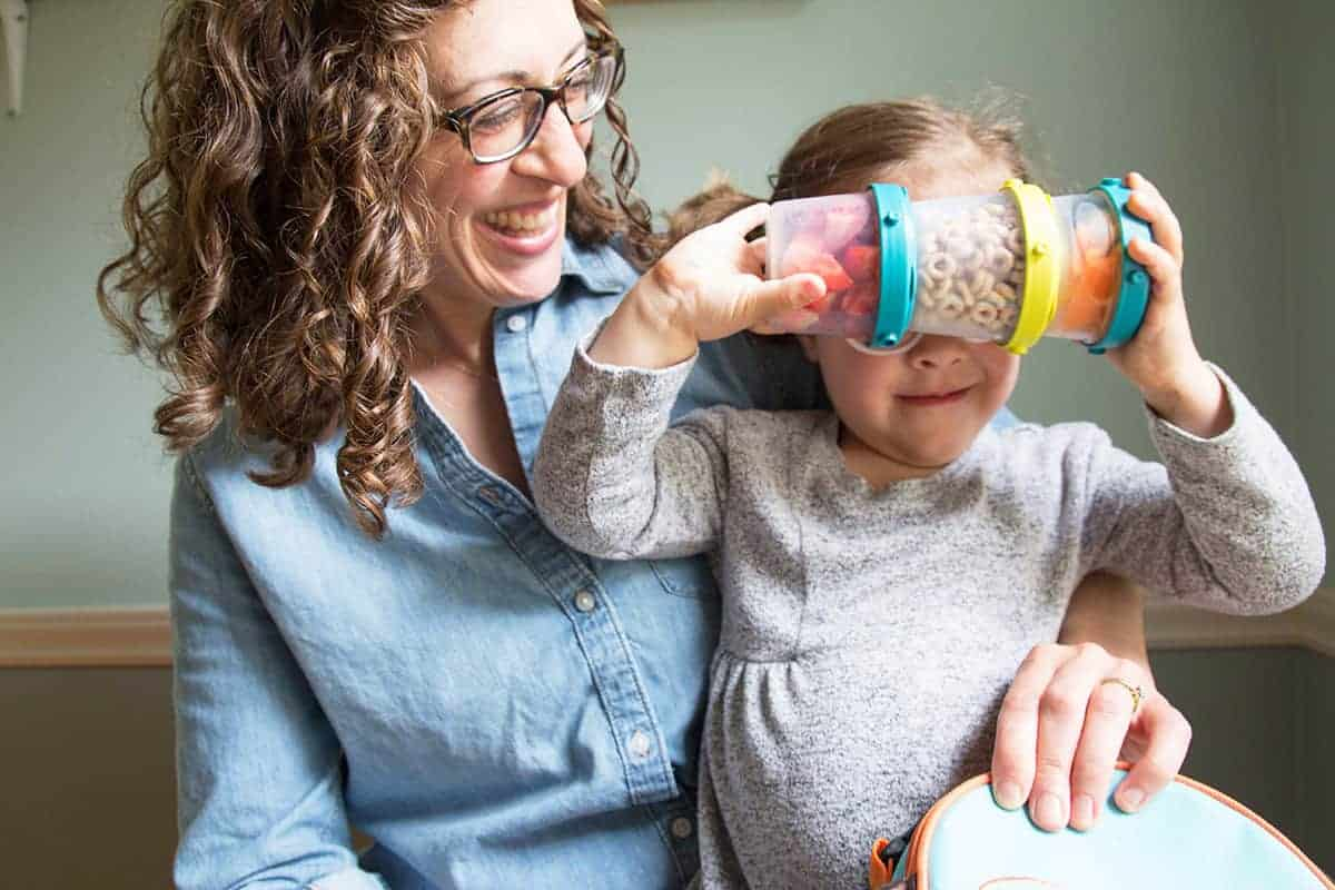 mom and toddler with snack cups
