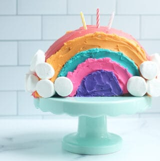 rainbow-cake-with-candles-on-cakestand