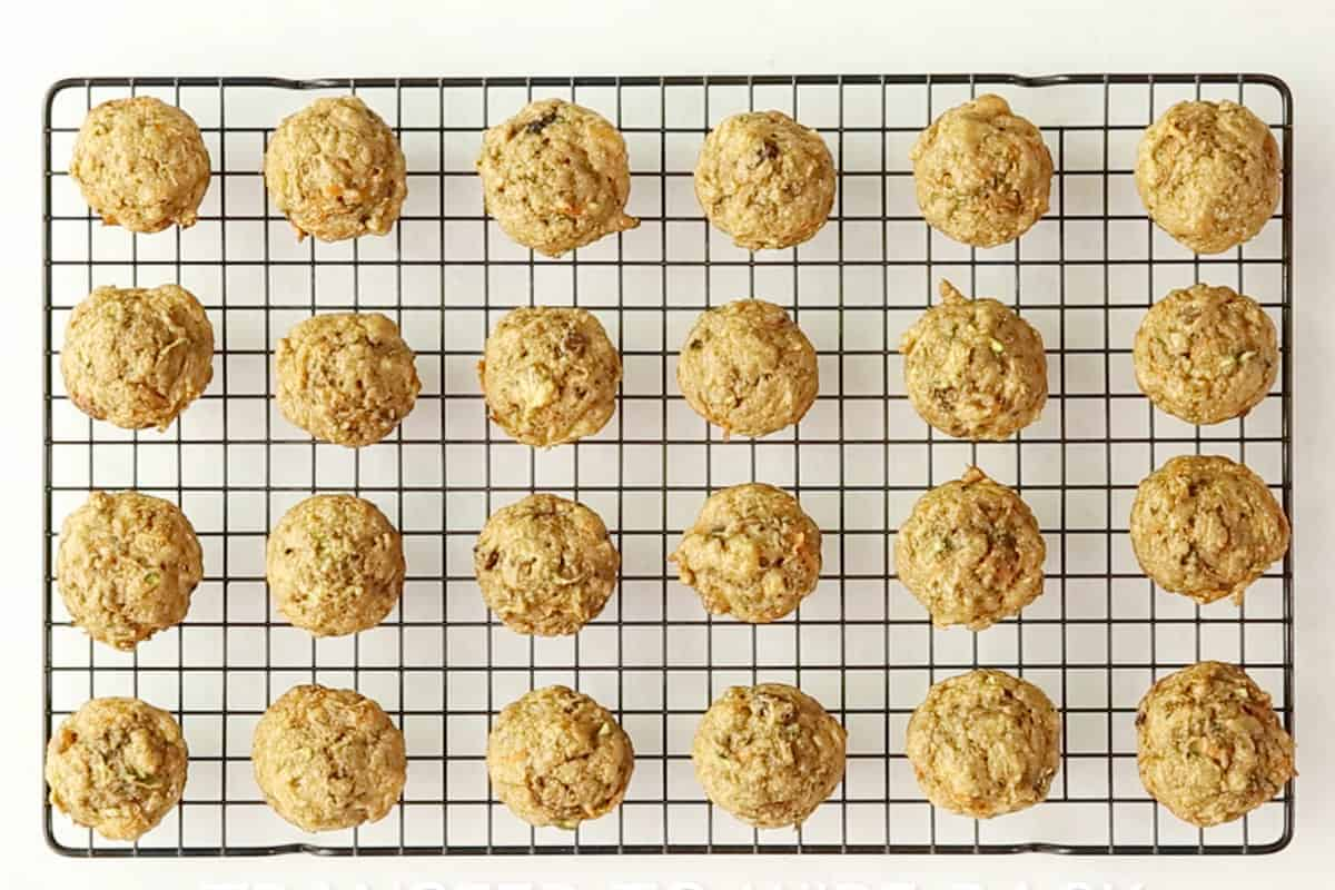 zucchini carrot muffins on wire rack