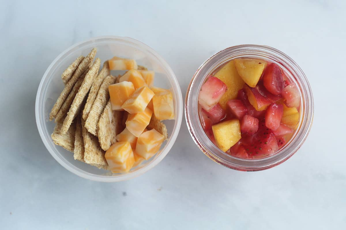 cheese, crackers, and fruit cup in containers