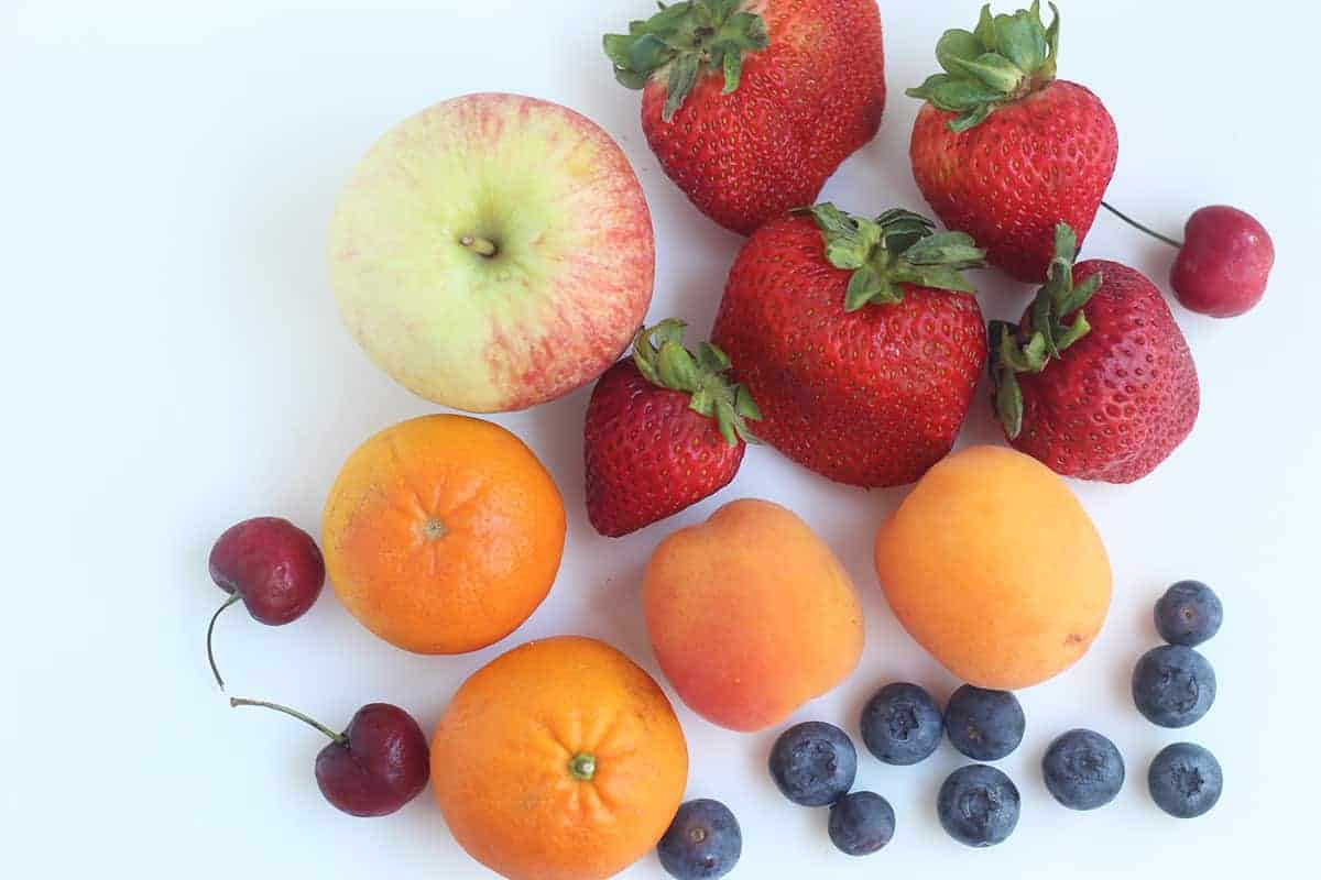 fruit for fruit cups on cutting board