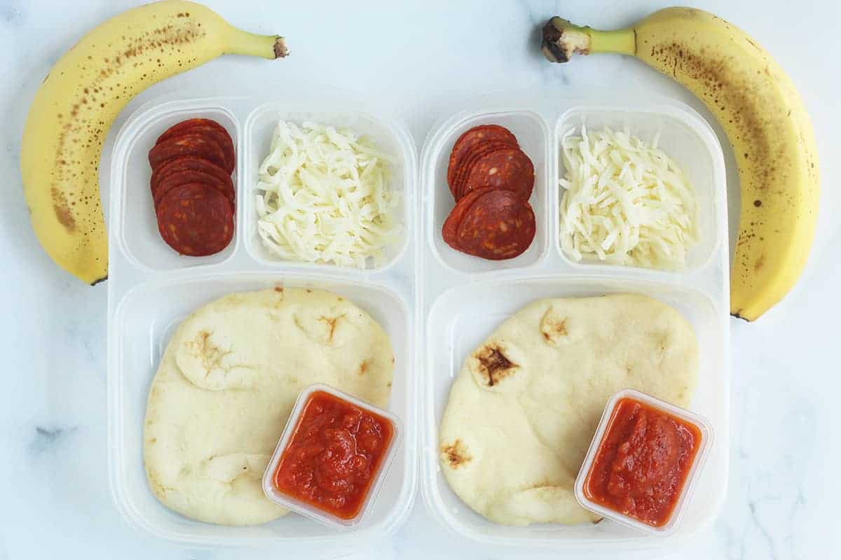 two pizza lunchables on the counter with bananas