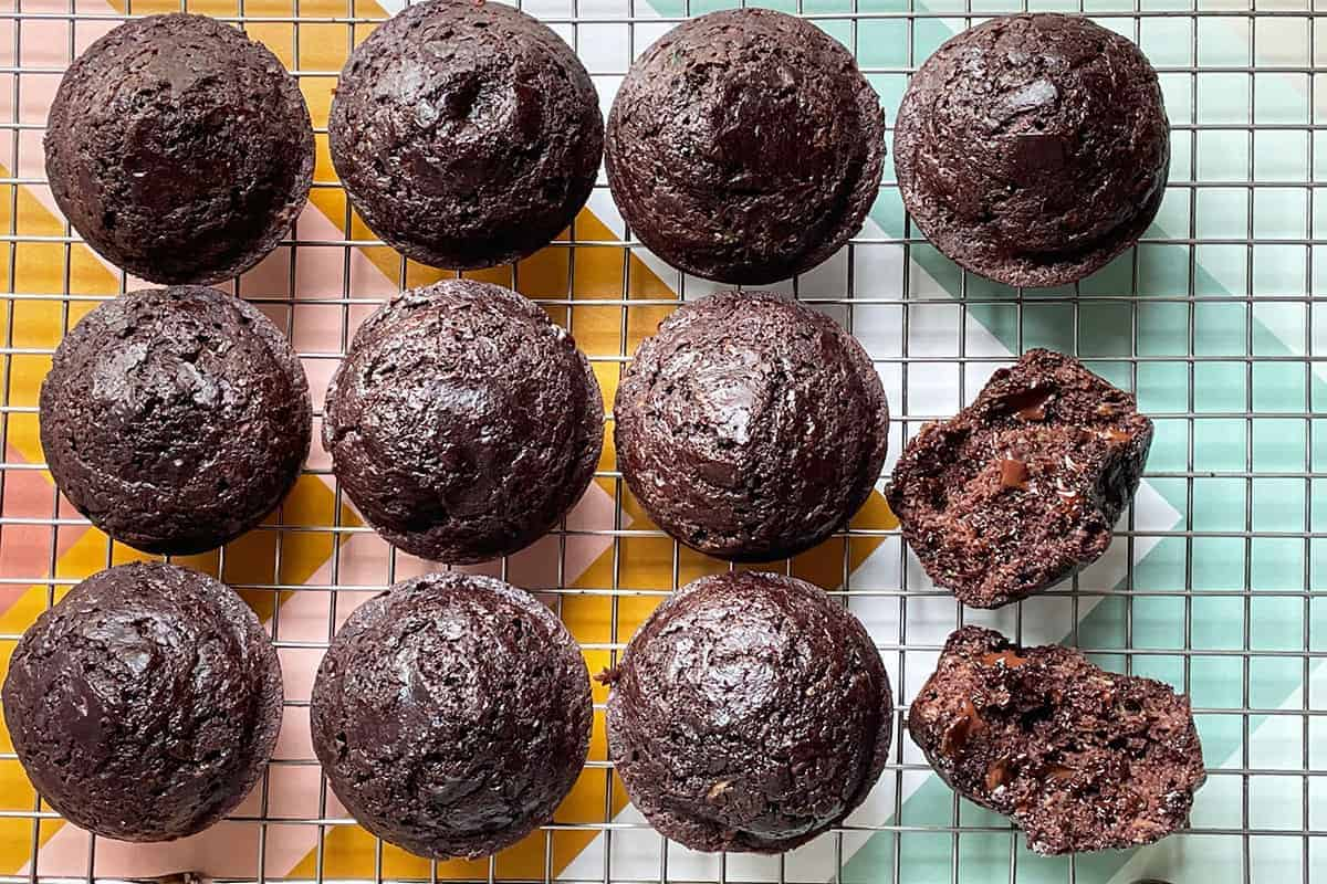 chocolate chip zucchini muffins on wire rack