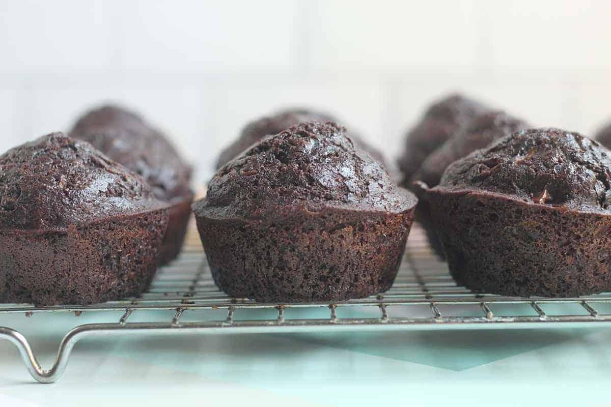 chocolate chip zucchini muffins cooling