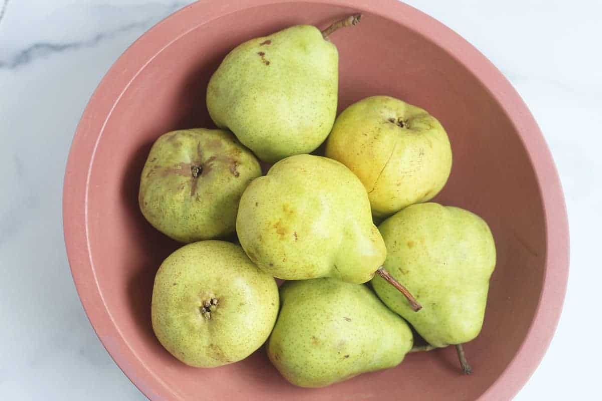 pears in pink bowl
