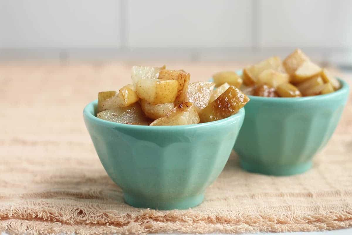 sauteed cinnamon pears in teal bowls