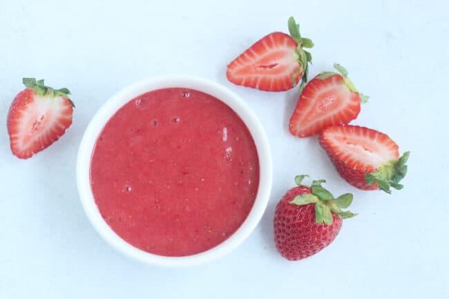 strawberry puree in white bowl