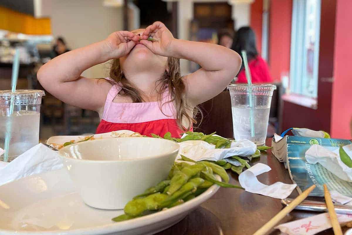toddler-eating-edamame-at-restaurant