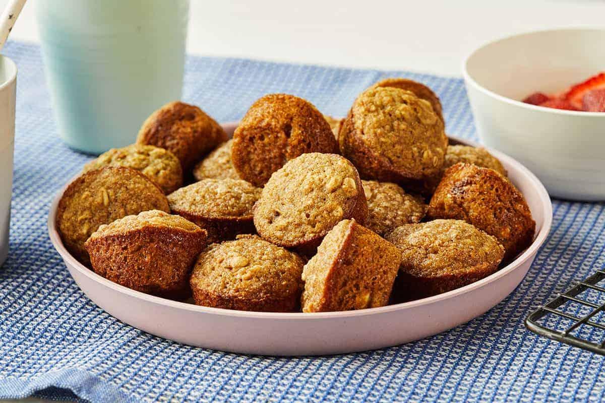 mini applesauce muffins on pink plate