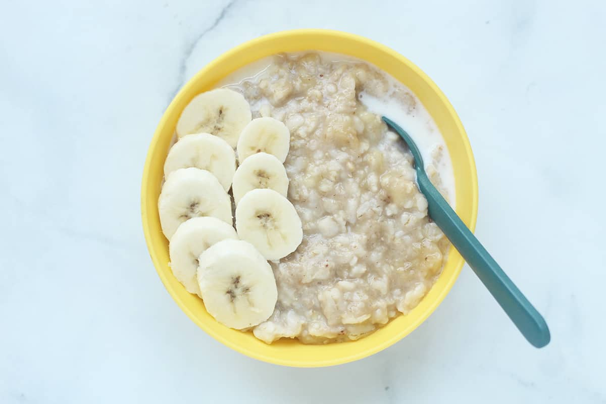 banana oatmeal in yellow bowl