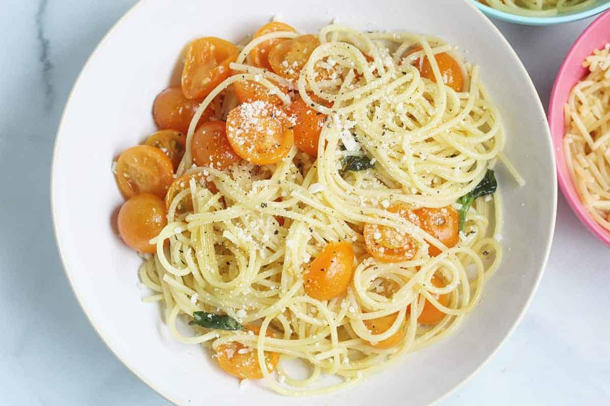 sungold cherry tomato pasta in in white bowl