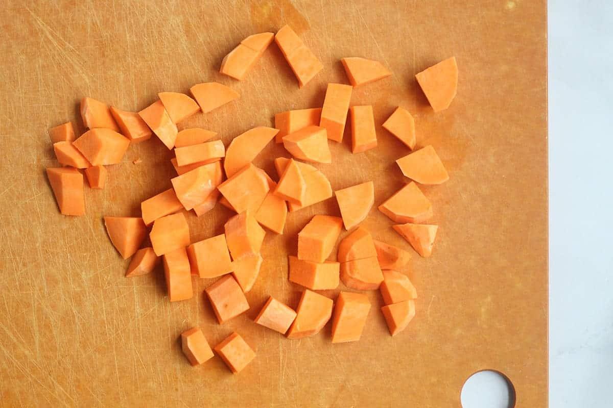 diced sweet potato on cutting board