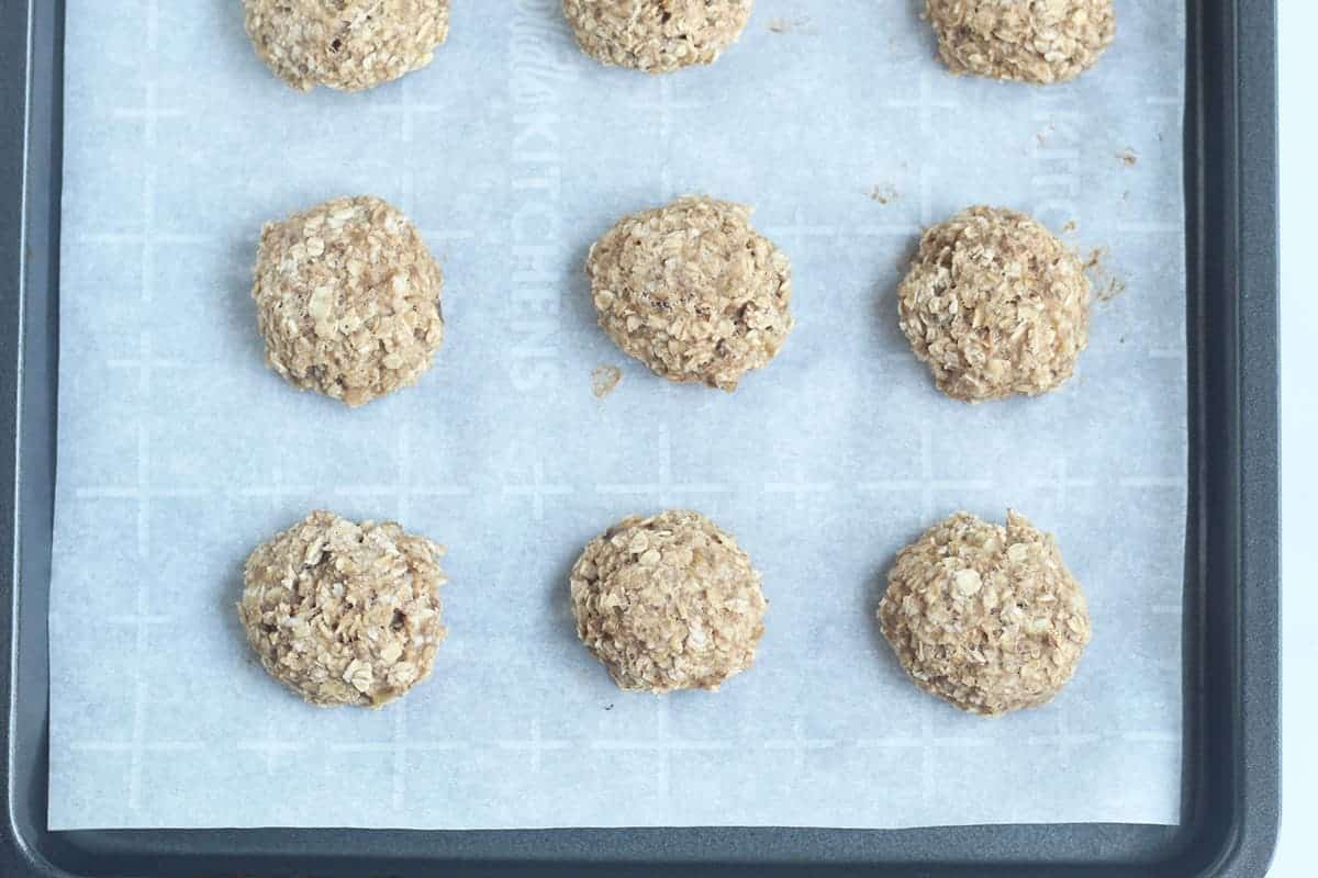 baked baby cookies on parchment lined sheet pan