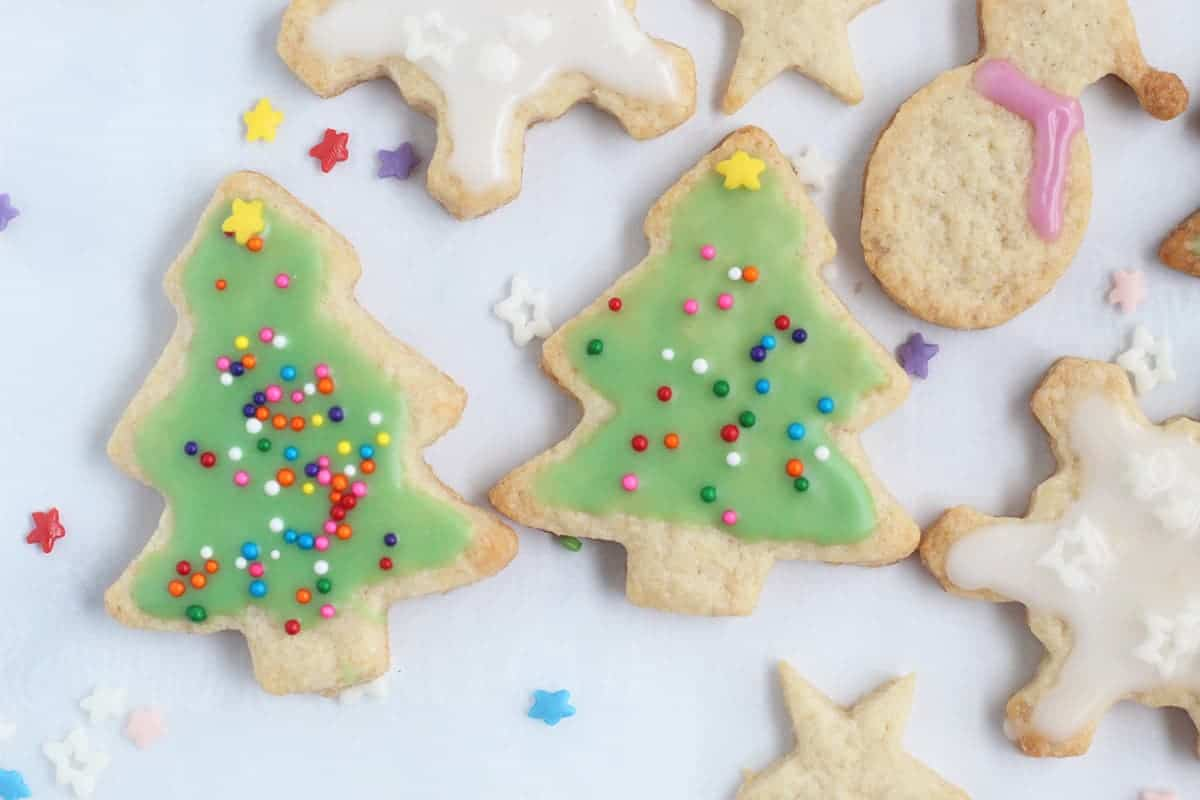 christmas tree cookies with sprinkles on parchment