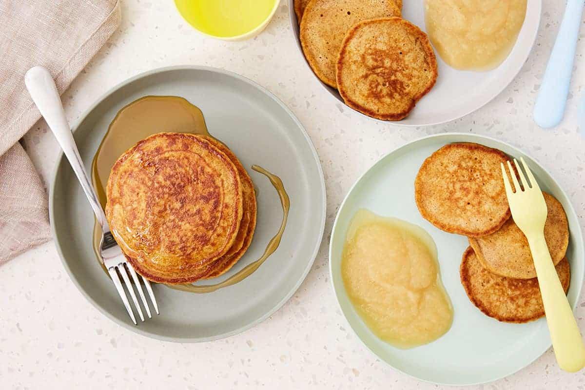 sweet potato pancakes on plates with applesauce